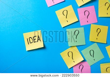 How to find a good lucrative idea for a startup business? Office stickers with question marks.