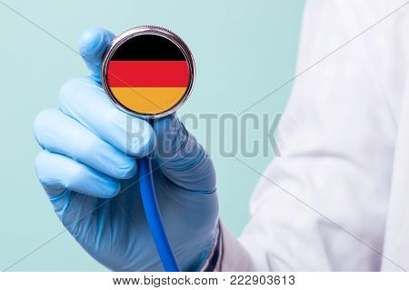 Medicine in Germany is free and paid. Expensive medical insurance. Treatment of disease at the highest level Doctor holding a stethoscope in his hand