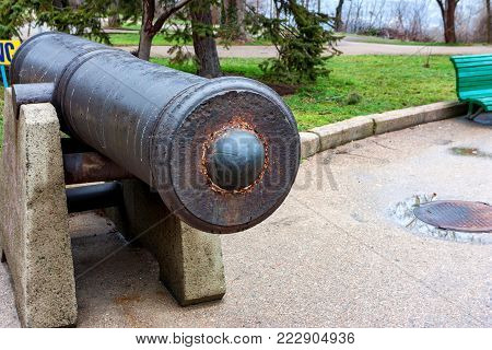 Close up obsolete old cannon exposed on embankment in Sevastopol, Russian military port city