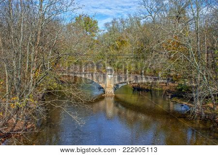 An abandoned old concrete bridge spans the Musconetcong River in the historic village of Ilmlaydale in New Jersey.
