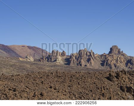 View On Famous Rock Formation  Roques De Garcia And Colorful Volcanic Mountain And Lava Desert On Te