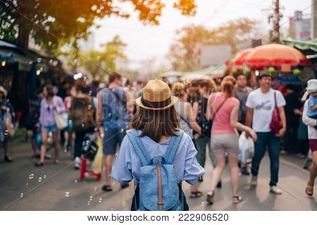 Young Woman Traveler With Sky Blue Backpack And Hat Looking The Way With In Jj Market In Bangkok Tha