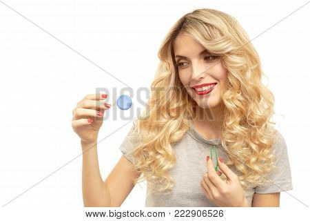Lovely girl holding contact lenses box for correcting eye disease