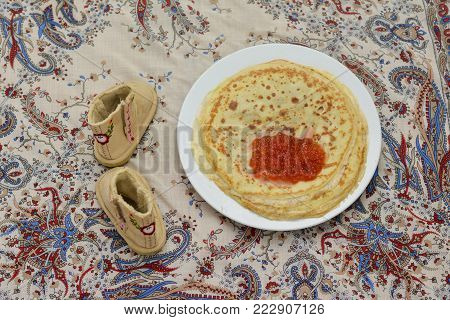 Pancakes with a red caviar. Shrovetide Maslenitsa Felt boots for small girl