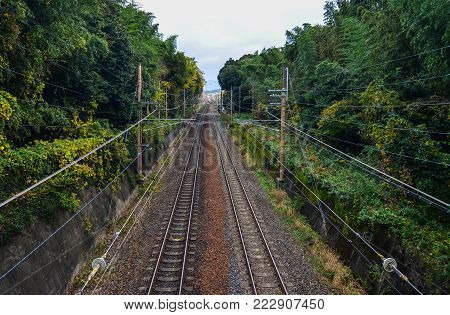 Rail Tracks At Countryside In Kyoto, Japan. Rail Transport In Japan Is A Major Means Of Passenger Tr