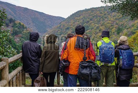 Kyoto, Japan - Nov 28, 2016. People looking at mountains of Arashiyama in Kyoto, Japan. Arashiyama is a nationally designated Historic Site and Place of Scenic Beauty.