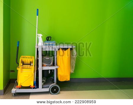 Cleaning tools cart wait for cleaning.Bucket and set of cleaning equipment in the office. janitor service janitorial for your place. Concept of service, worker and  equipment for cleaner and health