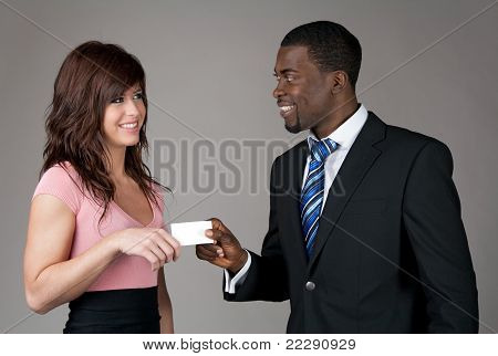 Businessman Giving His Business Card To A Young Woman