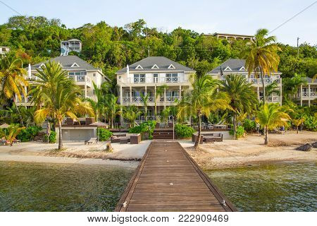 Antigua, Caribbean islands, English Harbour - May 19, 2017: Beach South Point Hotel, view with pool and palms