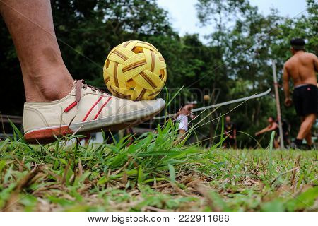 The feet with rattan ball in the garden.