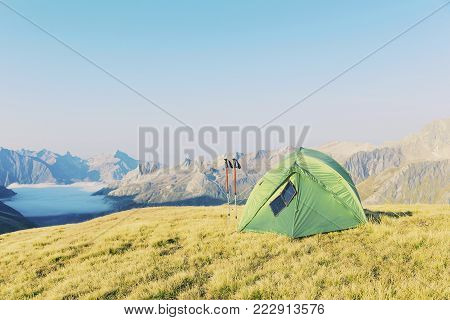 Tent Standing On A Mountain Top.