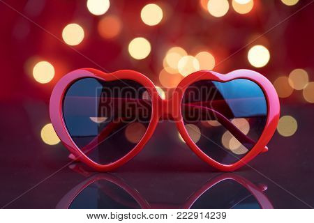 Heart shape eyeglasses with decoration light bokeh background as Valentine's day party concept.