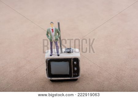 Retro syled tiny television and a figurine