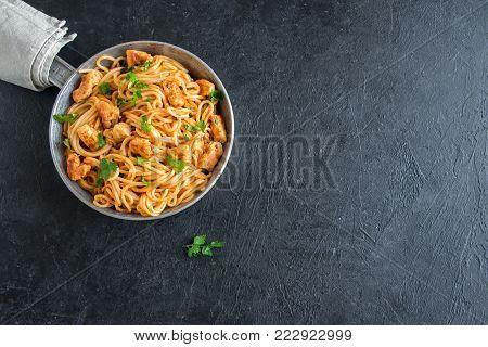 Spaghetti pasta with tomato sauce and chicken