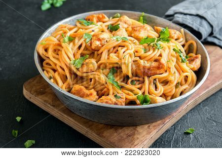 Spaghetti pasta with chicken and tomato sauce