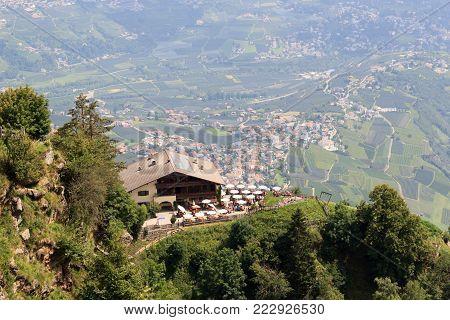 Mountain Inn Hochmuth and village Tirol panorama in South Tyrol