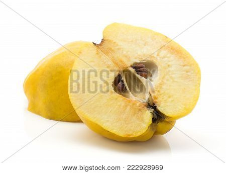 Yellow quince two halves isolated on white background raw ripe