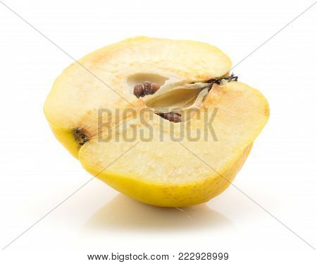 Yellow quince one sliced half with seeds isolated on white background raw ripe