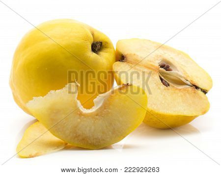 Yellow quince with one cross section half and two slices without seeds isolated on white background raw ripe