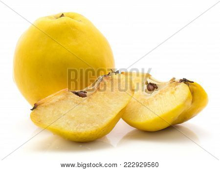One yellow quince with two slices isolated on white background raw ripe