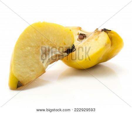 Two quince slices isolated on white background raw with seeds