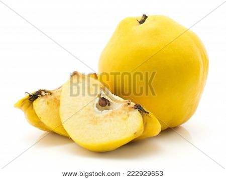 One quince and two slices isolated on white background raw yellow ripe with seeds
