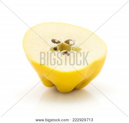 One quince half isolated on white background raw yellow with seeds poster