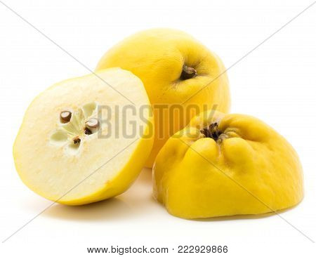 Sliced quince set isolated on white background raw yellow one whole and two halves with seeds