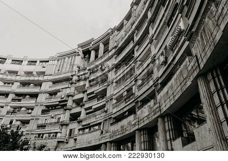 Architectural forms, loggias of a semicircular building in the center of Bucharest in Romania.
