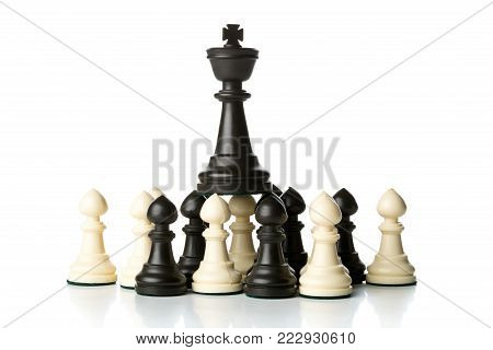 King chess figure standing on top of pawn chess figures - management, leadership, teamlead or strategy concept over white background