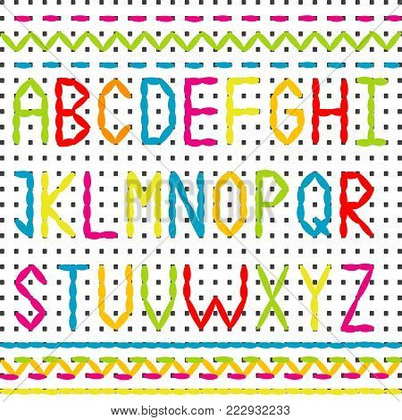 Embroidered alphabet and sewing stitched borders on white