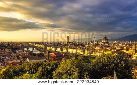 Florence or Firenze sunset aerial cityscape. Panorama view from Michelangelo park square. Ponte Vecchio bridge, Palazzo Vecchio and Duomo Cathedral. Tuscany, Italy poster