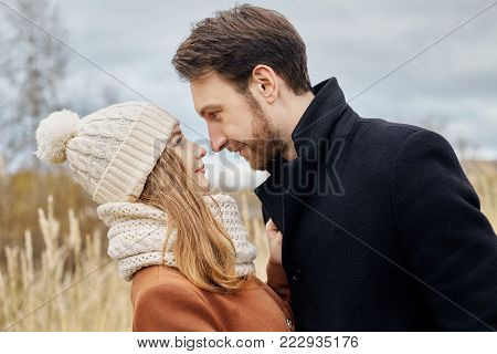 Couple In Love Walking In The Park, Valentine's Day. A Man And A Woman Embrace And Kiss, A Couple In