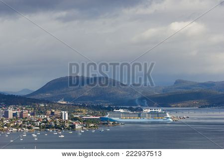 Hobart, Tasmania, Australia - 17 December 2017: Derwent estuary with cruise ship docking in Hobart harbour