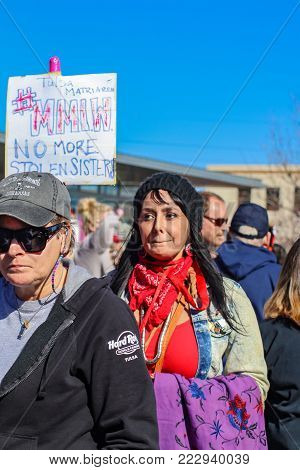 Native American woman marching with No More Stolen Sisters sign in Tulsa Womens March 1-20-2018