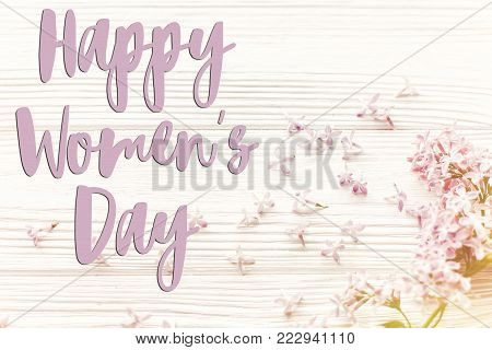Happy Women's Day Text Sign, Greeting Card. Hello Spring Image. Beautiful Tender Lilac Flowers And P