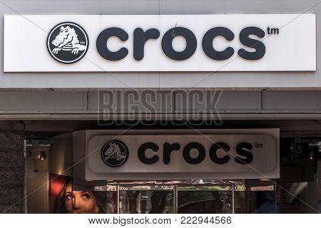 BOSTON UNITED STATES 05.09.2017 - Crocs footware retail store Logo for Foam clog style sandals open shoe design