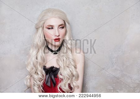 A model in stylish clothes. A stylish woman. Girl with a stylish hairstyle. Young stylish woman. Model in a stylish dress. Luxurious stylish blonde woman with beautiful long white hair