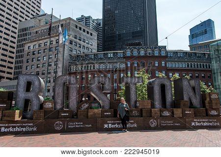 Boston MA USA 04.09.2017 - Boston city name sign with Skyline background