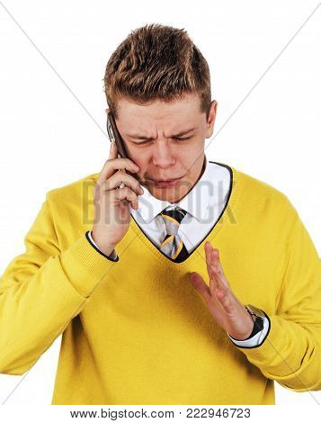 Listen to my compelling arguments. Handsome young man in business clothes, gently talking on mobile phone and hand gestures explains something against white background