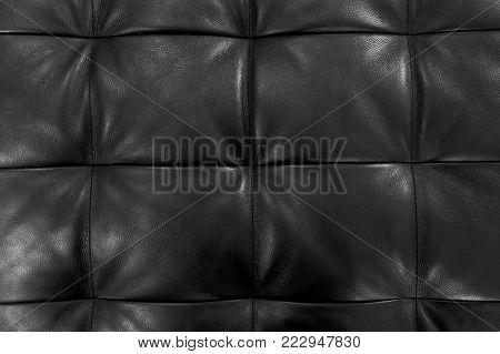 Background Pattern, Closed Up of Abstract Texture of Luxury Black Leather Sofa or Upholstery.