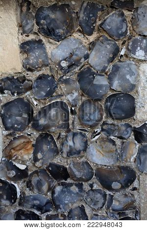 A flint wall in East Anglia, England. Flint, a variety of chert, has been used as a building material since Roman times