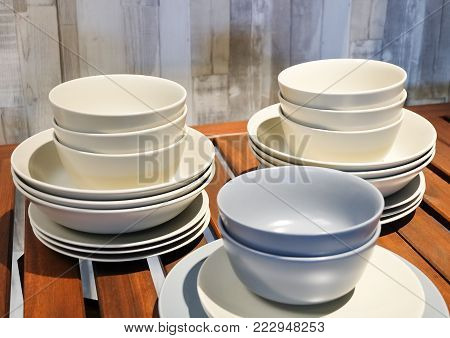 Kitchen Utensil, Collection of White and Blue Porcelain Dishes, Bowls and Plates Preparing for Serve Hot and Cold Food.
