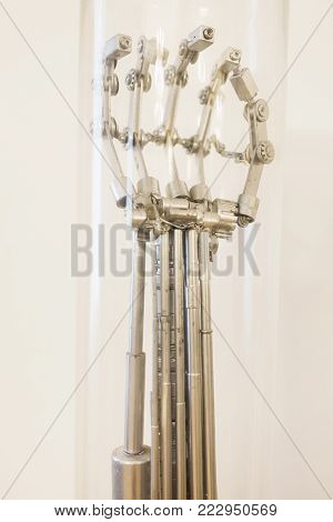 Robot from recycled raw materials. A terrible robot. Conceptual photography with a robot. The art of creating robots. The metal arm of the robot. Modern technologies