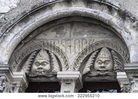 architectural detail on a building in Chartres France showing stylized characters