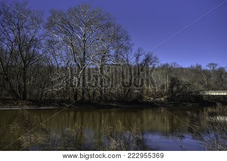 Brandywine Creek in Wilmington, Delaware with a bright blue sky and reflections in the water