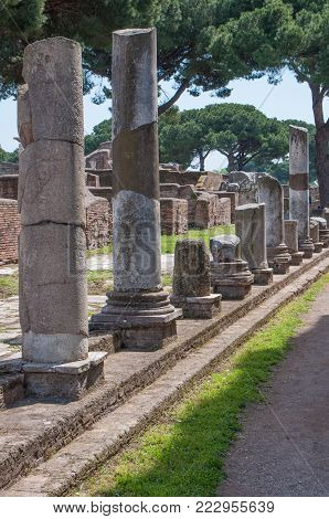 Ostia Antica, Italy - April 23, 2009 - Column ruins in the archeological site of the harbor city of ancient Rome, 15 miles southwest of Rome