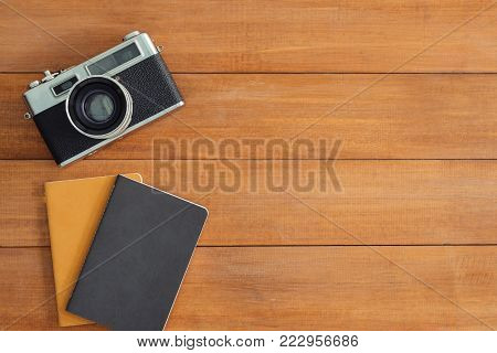 Minimal work space - Creative flat lay photo of workspace desk. Office desk wooden table background with mock up notebooks and retro camera. Top view with copy space, flat lay photography