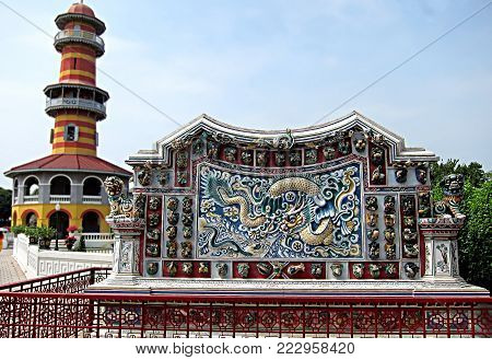 Detail of Chinese decorations outside Wehart Chamrunt (Heavenly Light), at the Bang Pa-In Bang Pa-In Royal Palace (summer palace), in Ayutthaya, Thailand.