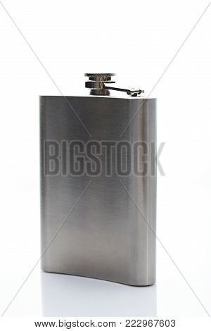 Metal flask stand side 45 degree isolated on white background. One silver shiny flask for drink